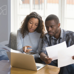 couple looking at taxes